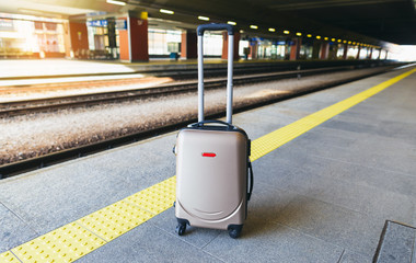 Suitcase on the platform of the railway station
