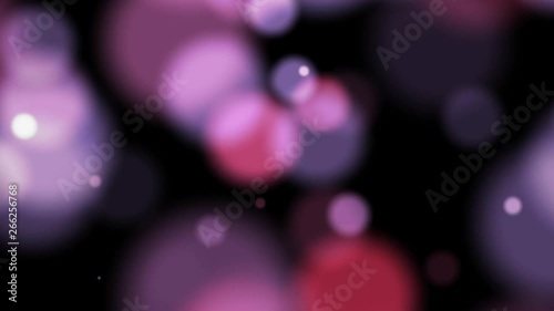 Abstract pink bokeh light blurred motion on dark background loop