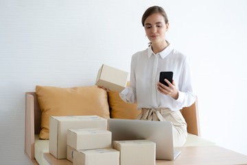 freelance woman working with box at home, small business owner online marketing packaging box and delivery, SME concept