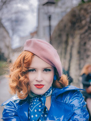 Typical portrait of a Parisian with red hair and beret