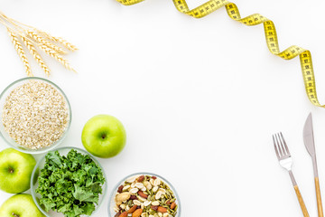Weight loss concept with green organic food on white background top view space for text Fotobehang