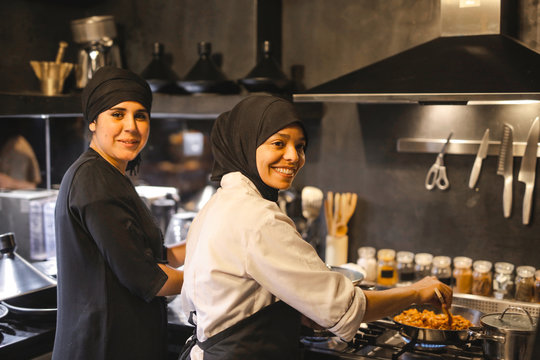 Two female cooks in a restaurant