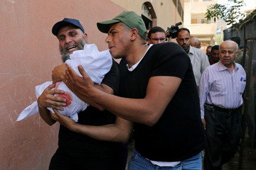 Relatives carry the body of 4-month old Palestinian baby girl Maria Al-Ghazali during her funeral, in Gaza City