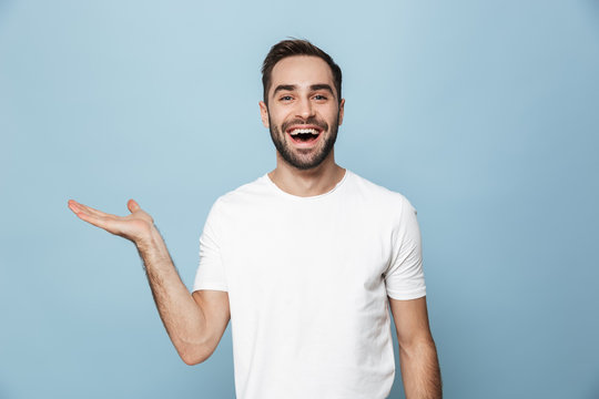 Cheerful excited man wearing blank t-shirt standing