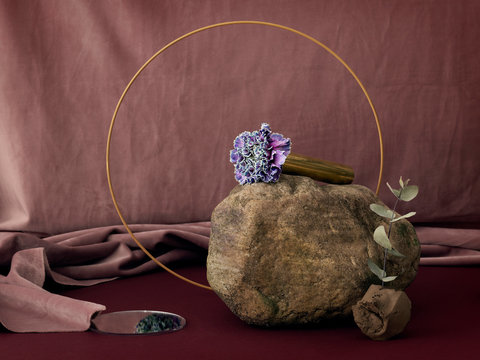 Rock with dusty rose backdrop and orange ring