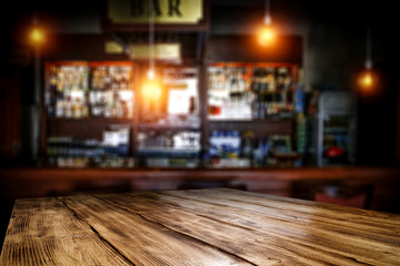 Fototapete - Table background of free space and blurred background of bar