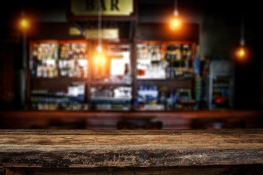 Table background of free space and blurred background of bar