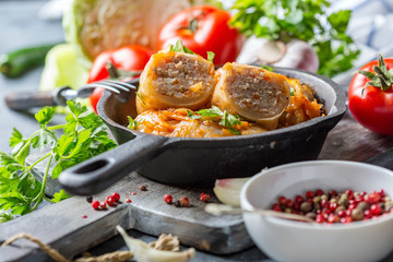 Traditional cabbage rolls with minced meat and tomato souce.