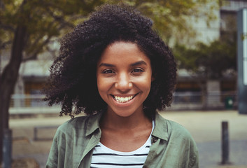 Portrait of a smiling afro american young woman Wall mural