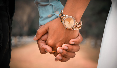 Couples, men, women holding hands together looking happy and loving each other Romantic atmosphere. Love pictures of Valentine's Day by touching the hand or wedding day.