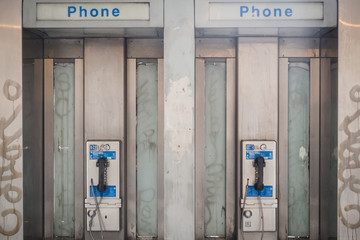 NEW YORK, USA - FEBRUARY 23, 2018: Old phone booths on the streets of Manhattan