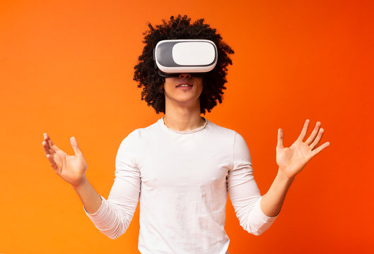 Young black man wearing virtual reality headset