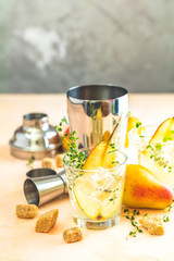 Cold summer cocktail drink with sweet pear
