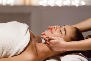 Face Massage. Therapist Massaging Woman's Neck And Chin
