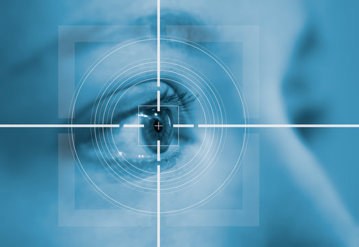 laser surgery concept close up of female eye with light flares
