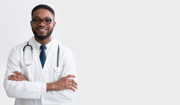 Happy Doctor In White Uniform Against Light Background
