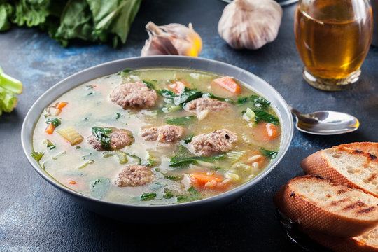 Italian wedding soup with meatballs and vegetables