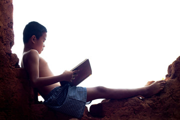 Asian boys are reading books in the clay house.
