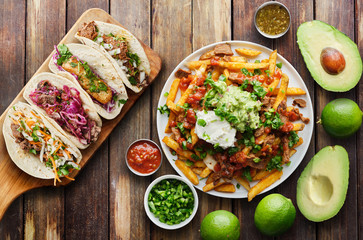 Wall Mural - mexican street tacos and carne asada fries in flat lay composition
