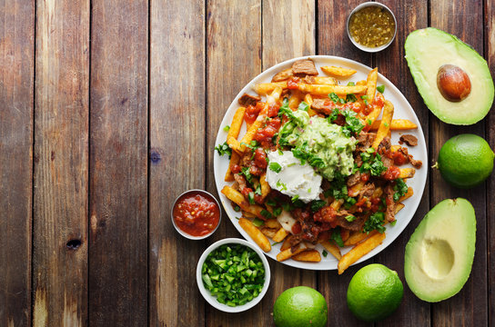 mexican carne asada fries in copy space composition shot from birds eye view