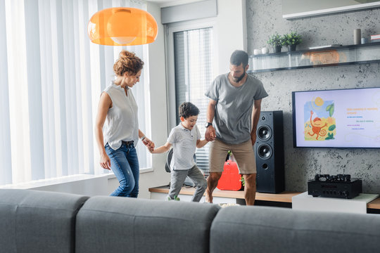 Parents Playing With Child