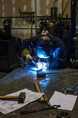 Welder in a blacksmith shop