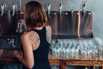 Female bartender with tattoo
