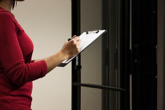 Technician in a server room.
