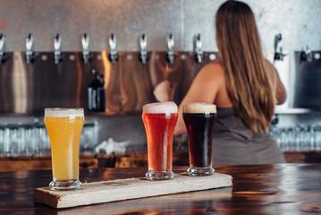 Bartender serving a flight of craft beer