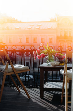 Tulips on a balcony with flare