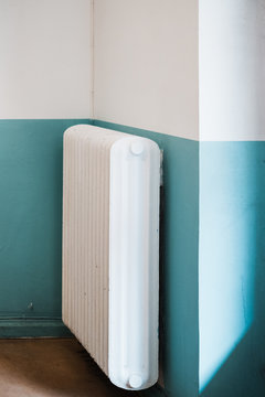 Heat radiator on a blue and white wall