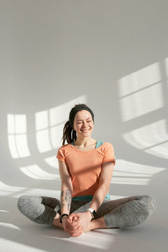 Cheerful woman at yoga class