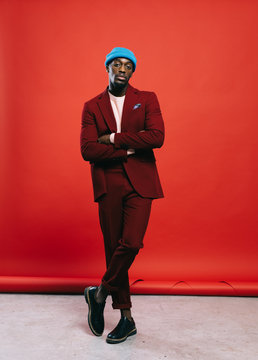 Black man in suit posing in studio