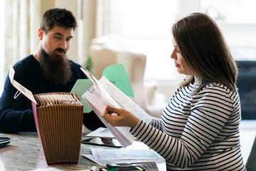 Taxes: Couple Going Through Tax Return Information