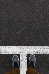Point of view to a Street marking on black asphalt