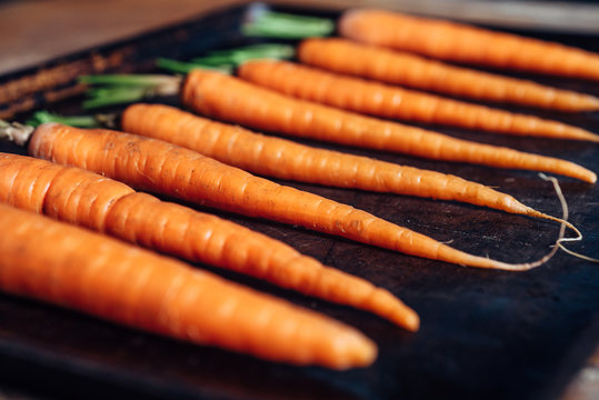Close up of fresh carrots in a tray