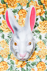 rabbit mask on a yellow and green floral pattern