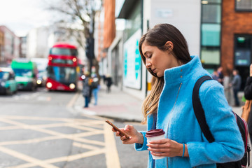 Woman using a Mobile phone in London