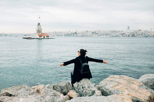 Woman enjoying the view in front of the Maiden?s Tower in Istanbul