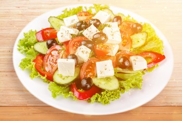 Wall Mural - Greek salad with fresh vegetables on desk