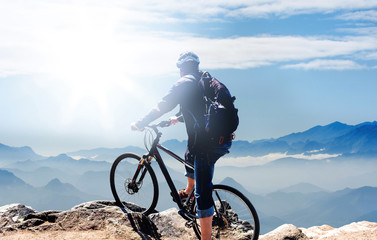 Reaching the top - cycling in the mountains at sunrise