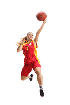 Female basketball player jumping with a ball