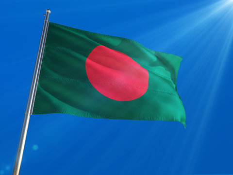 Bangladesh National Flag Waving on pole against deep blue sky background. High Definition