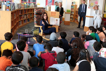 U.S. Senator Kamala Harris reads a book about kindness to students at Miller Elementary School in Dearborn