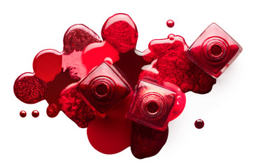 Red nail art cosmetics concept. Open nail polish bottles with different shades