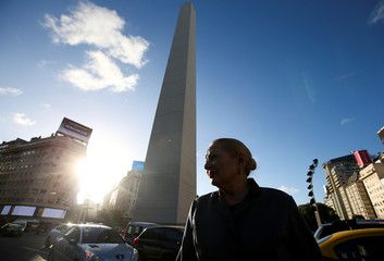 A woman dressed as former Argentina's First Lady Eva Peron, poses for a picture during a demonstration ahead of the 100th anniversary of Evita's birth, at the Buenos Aires Obelisk