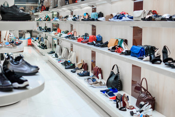 Long rows of shelves with shoes and bags in the store Wall mural