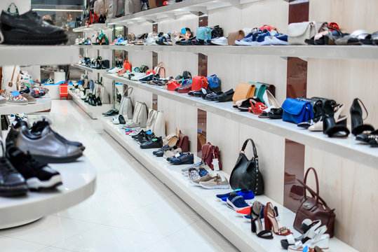 Long rows of shelves with shoes and bags in the store