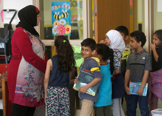 Students at Miller Elementary School stand in-line in the school library in Dearborn, Michigan,