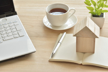 Wooden house on a book